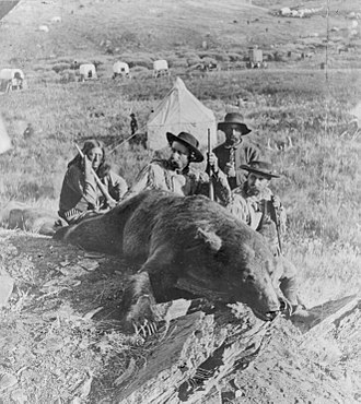Arikara scouts - Bloody Knife, Custer and Captain William Ludlow with a killed bear. All three claimed to have shot it. Custer received credit