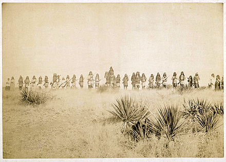 Photo by C. S. Fly of Geronimo and his warriors, taken before the surrender to Gen. Crook, March 27, 1886, in the Sierra Madre mountains of Mexico. Fly's photographs are the only known images of Indian combatants still in the field who had not yet surrendered to the United States. Geronimo and his warriors.jpg