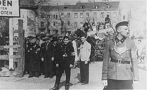 Łódź Ghetto - German and Jewish police guard at the entrance to the Ghetto