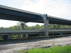 Two different girder bridges.  The top is a plate girder bridge, while the bottom is a concrete girder bridge.