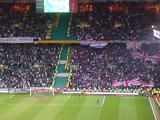 Sectarianism in Glasgow - Supporters of Celtic (left) and Rangers during an Old Firm match at Celtic Park in 2008. The Union Jack flags signify the Unionist culture of many Rangers supporters.