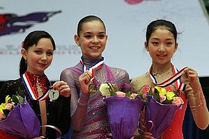 Adelina Sotnikova - Sotnikova with medalists Elizaveta Tuktamysheva and Li Zijun at the 2010–11 JGP Final
