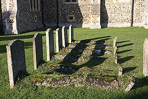Footstone - Row of graves with headstones (left) and footstones (right); Snailwell, England.