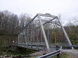 Grimms Bridge (1884) crosses the Little Beaver Creek east of Ohio State Route 170