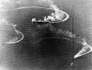 HIJMS Zuikaku and two destroyers under attack.jpg