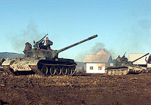 Two Croatian Defense Council (HVO) T-55 Main Battle Tanks pull into firing position during a three-day exercise held at the Barbara Range in Glamoč, ...