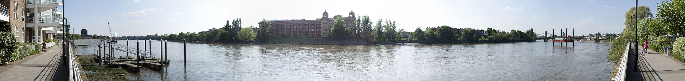 A panoramic view looking of the Thames at Hammersmith, opposite the Harrods Repository.