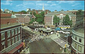 Harvard Square Subway Kiosk - Circa-1970s postcard of Harvard Square, showing Out of Town News in its former location (dark roof) next to the subway entrance kiosk