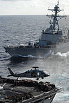 Helicopters and ships work together on vertical replenishment DVIDS110888.jpg