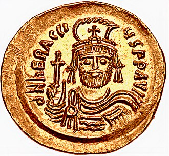 Heraclius - Solidus of Emperor Heraclius (aged 35-38). Constantinople mint. Struck 610-613. Helmeted and cuirassed facing bust, holding cross.