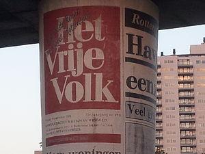 Het Vrije Volk - Front page of Het Vrije Volk on a metro pillar in Rotterdam