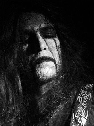 Black metal - A common black metal convention is the use of corpse paint, black-and-white make-up intended to make the wearer look inhuman, corpse-like, or demonic. Shown here: Taalroth of French Pagan black metal band Hindvir.