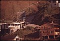 Houses Perched on a Hillside at Logan, West Virginia. Many Homes Are Built This Way Because Level Land Is at a Premium in the Valleys of This Coal Mining Area 04-1974 (3906435365).jpg