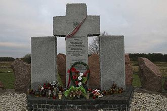 Massacres of Poles in Volhynia and Eastern Galicia - Cross with tablets of the names of Poles killed in completely destroyed Huta Pieniacka, in present-day Ukraine