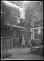 Hutt Railway Workshops, Woburn. Interior view with new heating apparatus, 1929. ATLIB 290007.png