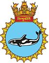 Submarine crest with a large, black-and-white fish