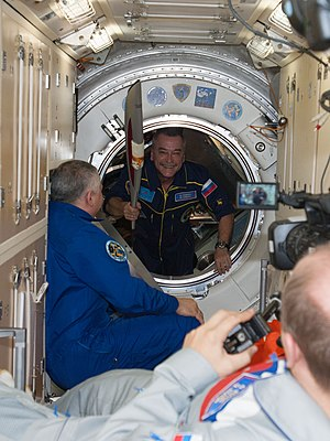 Mikhail Tyurin - Expedition 38 Flight Engineer Mikhail Tyurin seen holding the Olympic torch as he enters the ISS.