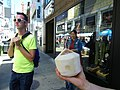I saw this guy drinking a drink from a fresh coconut, Buskerfest, 2014 08 24 (14840669390).jpg