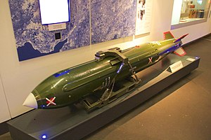 Image shows a museum exhibit of a WE.177, which was Britain's last free-fall nuclear bomb. The example shown is a decommissioned training example, re-painted in its 'live' green colour scheme. It is on display at the Imperial War Museum North, in Manchester, England.
