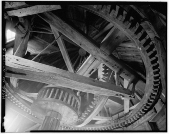 Interior view of Pantigo Windmill, looking up into cap from floor--cap rack, brake wheel, brake, and wallower. Pantigo Windmill is located on James Lane, East Hampton, Suffolk County, Long Island, New York. Interior view Pantigo Windmill East Hampton Suffolk County New York(2).png