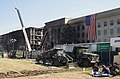 Investigators take a break from their grim task near the destruction at the Pentagon's west side 010913-A-HL605-007.jpg