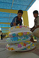 Iraqi youths help to blow up water rings in preparation for the grand reopening of the al-Amana swimming pool, located in the Zayuna neighborhood, Eastern Baghdad, Iraq, Aug. 7, 2008 080807-A-YE931-067.jpg