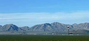 Ivanpah Solar Power Facility - View of Ivanpah Solar Electric Generating System from Yates Well Road. The Clark Mountain Range can be seen in the distance