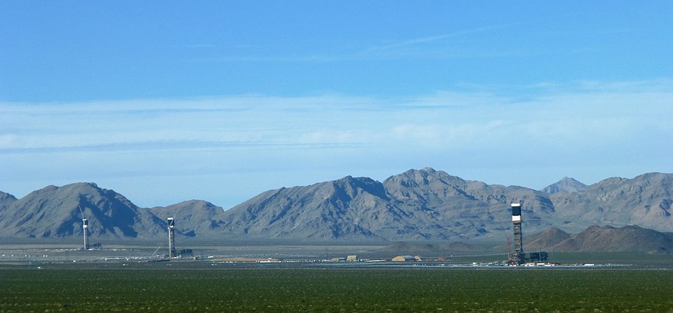 View of Ivanpah Solar Electric Generating System from Yates Well Road, San Bernardino County, California. The Clark Mountain Range can be seen in the distance.