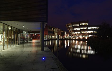 Long-exposure photo of the University of Nottingham Jubilee Campus at night.