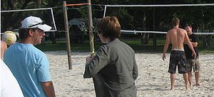 The Last Song (film) - Director Julie Anne Robinson talks to stunt coordinator Cal Johnson while Liam Hemsworth is coached on beach volleyball.