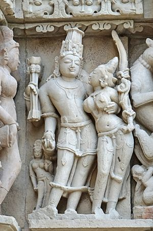Vasant Panchami - Vasant Panchami, in some parts, celebrates the Hindu god of love Kama (left) with Rati, shown above at the Khajuraho temple.