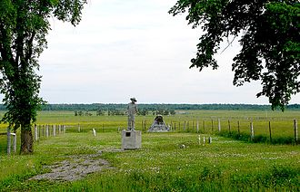 "Ukrainian Canadians - Commemorative statue entitled ""Never Forget"" / ""Ne Jamais Oublier"" / ""Nikoly Ne Zabuty"", by John Boxtel; and damaged plaque at the cemetery of the Kapuskasing Internment Camp, Kapuskasing, northern Ontario"