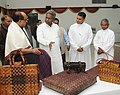 Kavuru Sambasiva Rao and the Minister of State (Independent Charge) for Consumer Affairs, Food and Public Distribution, Professor K.V. Thomas visiting the Natural Fibre Craft Exhibition 2013, in New Delhi.jpg