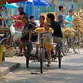 Kid is playing on old cycle.jpg