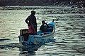 Lébous sur une pirogue de pêcheurs à Soumbedioune.jpg