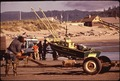LAUNCHING A BOAT AT CAPE KIWANDA. THE CAPE IS A PROSPECTIVE SITE FOR A NUCLEAR POWER PLANT - NARA - 545223.tif