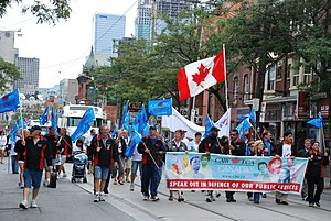 Canadian Auto Workers - CAW members marching in the 2011 Labour Day parade in Toronto