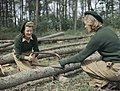Land Army girls sawing larch poles for use as pit props at the Women's Timber Corps training camp at Culford in Suffolk. TR912.jpg