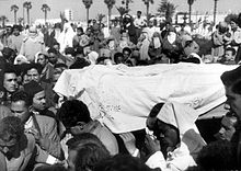 A black and white photo of the funeral of Touria Chaoui in Morocco.