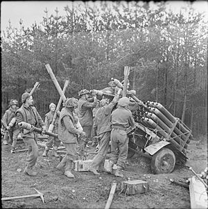 Operation Veritable - RP-3 rockets being loaded into Land Mattress launchers in preparation for the offensive in the Reichswald, Germany