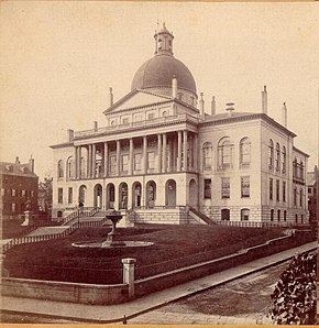 The Massachusetts State House c. 1862, in a stereograph image, before the addition of wings. The copper dome was first painted a warm gray to appear as stone, and was gilded in 1872.