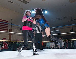 Malia Hosaka - Hosaka (in blue) executing a clothesline