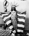 Woman with crown, holding a large flag