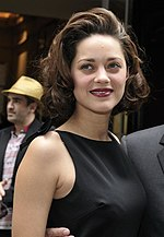 Photo of Marion Cotillard attending the Haute Couture Autumn-Winter fashion show in 2009.