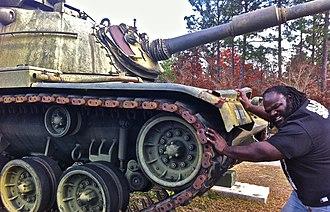 Mark Henry - Henry pretending to push a tank