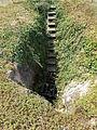 Megalodus-barlang alsó (fő) bejárat. Lépcsősor. Geológus Kert. - Tata.JPG