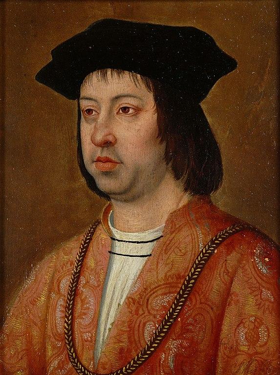 A portrait of Ferdinand II of Argon wearing a black hat and a dark orange robe