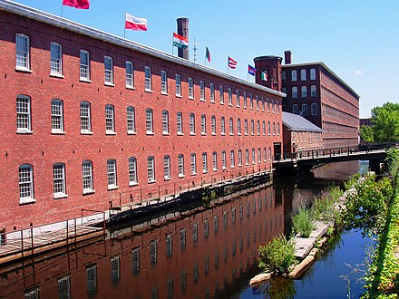 Textile mills such as the Boott Mills in Lowell made Massachusetts a leader in the Industrial Revolution in the United States. Mill Building (now museum), Lowell, Massachusetts.JPG
