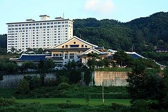 Korean Minjok Leadership Academy - Sun sets over Dasan Hall and the student dormitory.