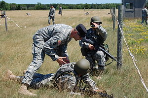 Camp Ripley - Instructor gives an Officer Candidate tactical advice during a training exercise at Camp Ripley
